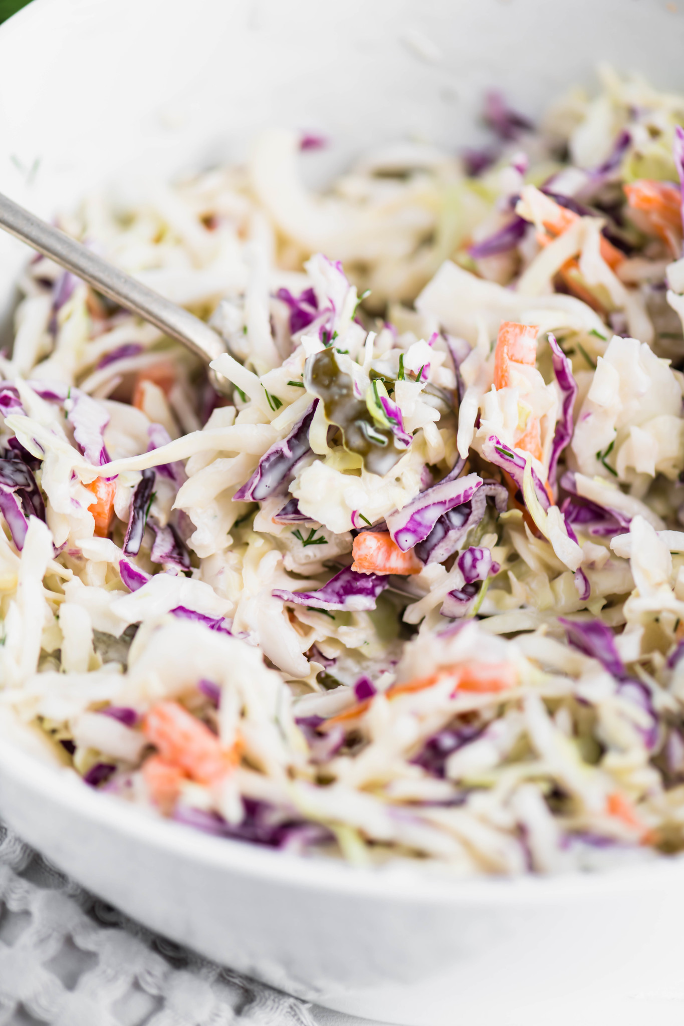 Change up your classic coleslaw with this Dill Pickle Coleslaw. Creamy dressing spiked with pickle juice, chopped pickles and fresh dill brings all the pickle flavor.