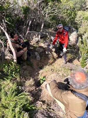 Travaux d'entretien dans la montée du PR avant la grotte : Jean-Jo, Philippe et Jacques