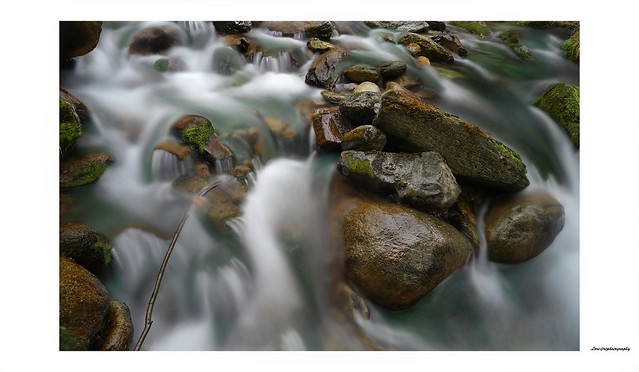 Movement among the rocks... 24 mm. 2.8 Nikkor Ais  shot f 16  iso 64   ND filter  - 8 Ev