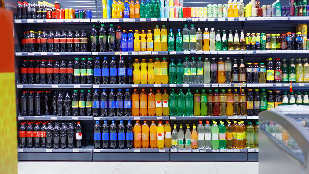 Image of soft drinks aisle in supermarket.
