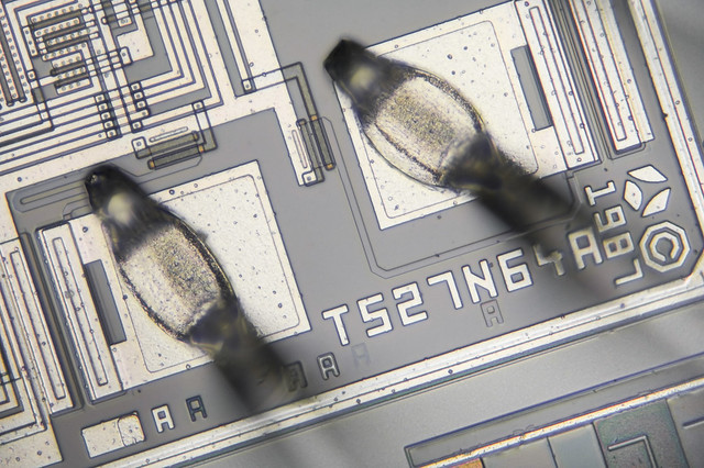Microphotography 52:1 Fragment of Microchip TMS 2564JL LHP1701