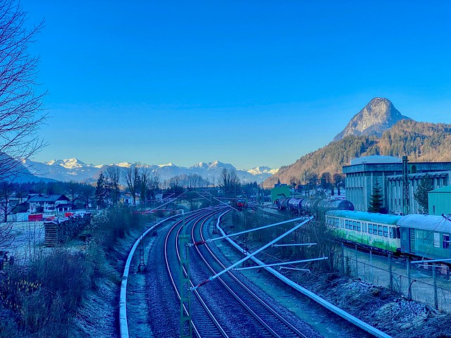 Railway tracks in Kiefersfelden in Bavaria,Germany with Pendling mountain and the Alps