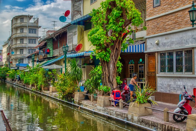Houses by the canal (khlong) on Rattanakosin island (Old Town) in Bangkok, Thailand