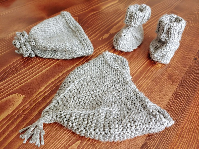 Homemade knitted baby hats with matching booties