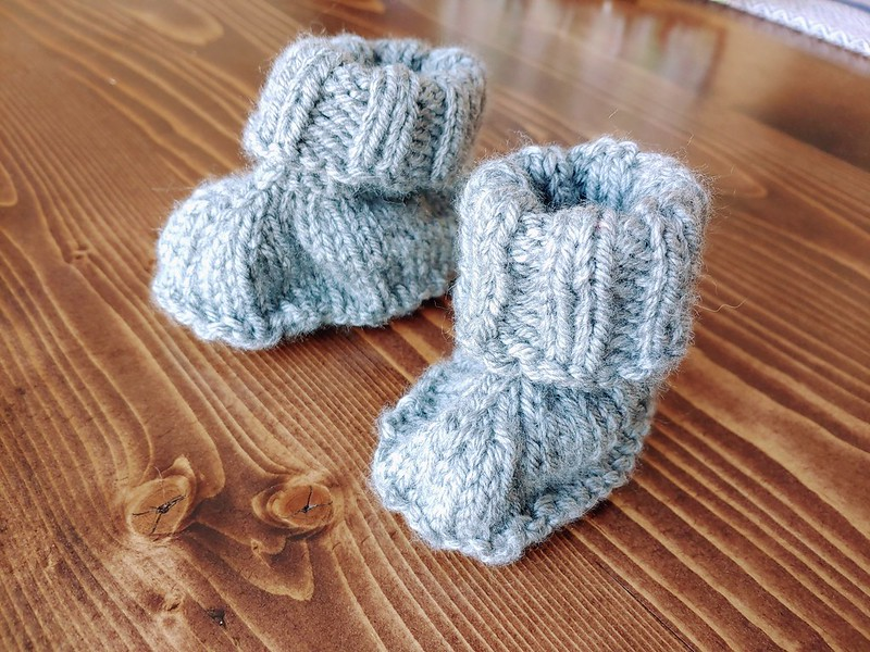 Gray knitted baby booties