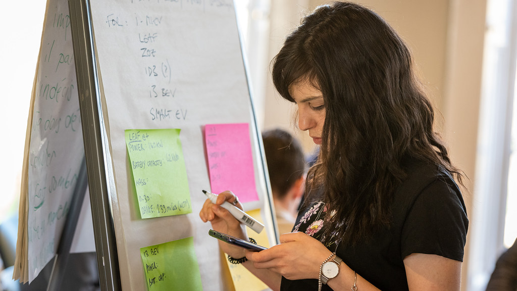 AAPS Cohort 1 Student at ITT event, using sticky notes