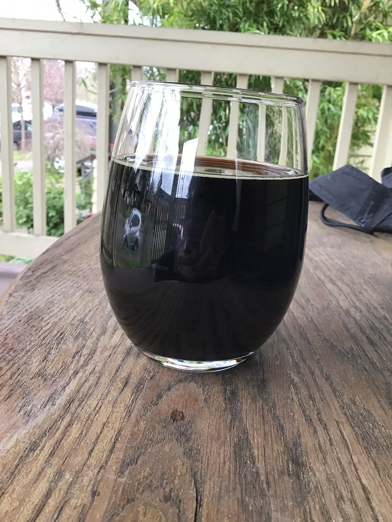 2015 Full Sail bourbon barrel aged stout in glass on table outside
