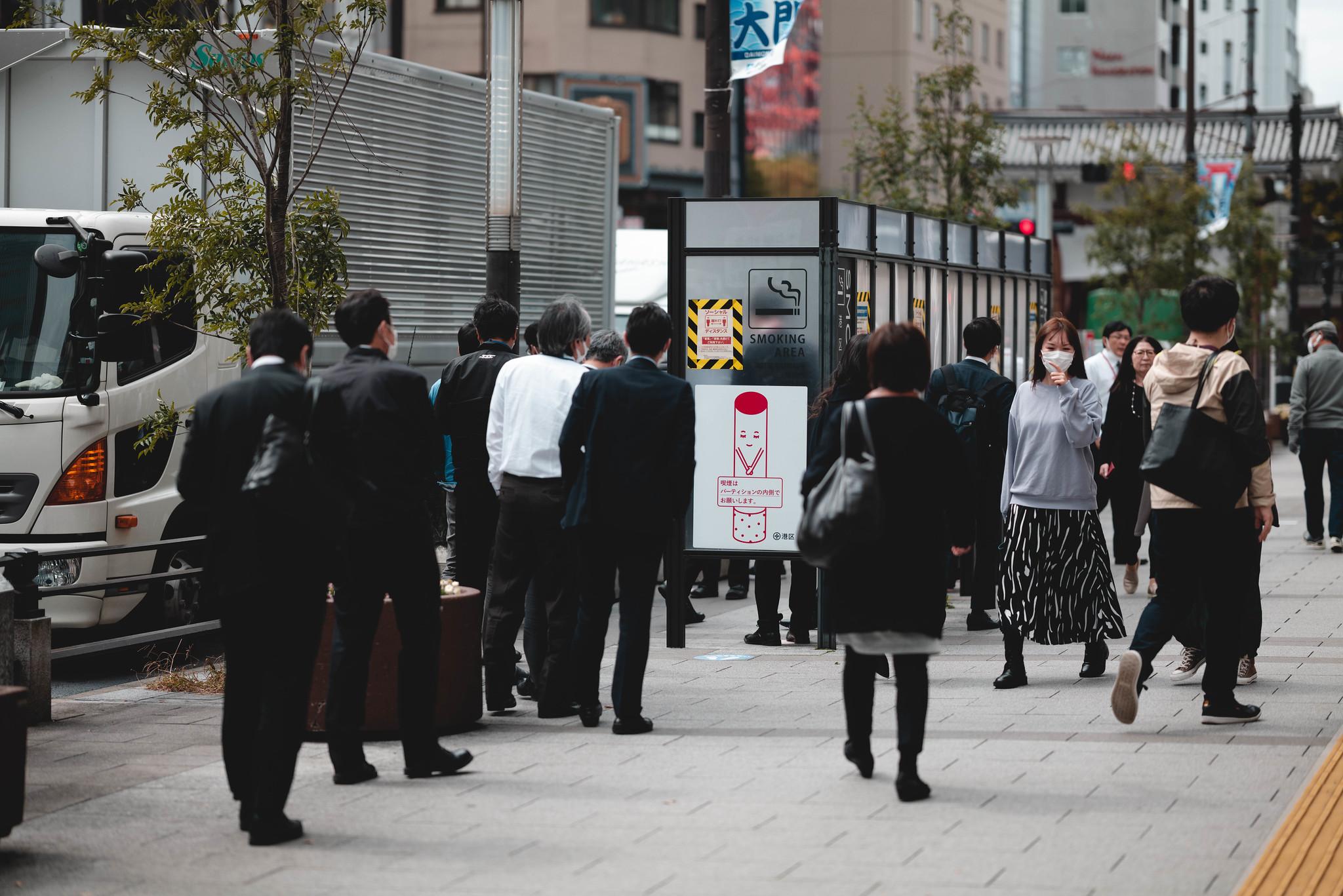 Smoking area with a queue