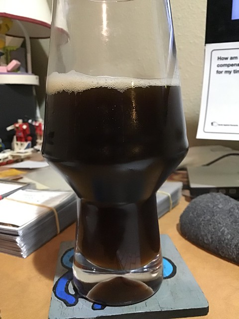 Brown ale in glass on desk