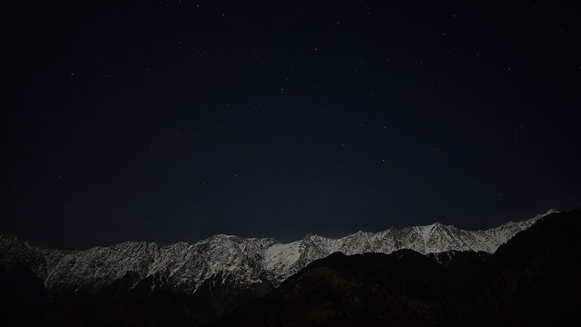 Moonlit snowy mountains