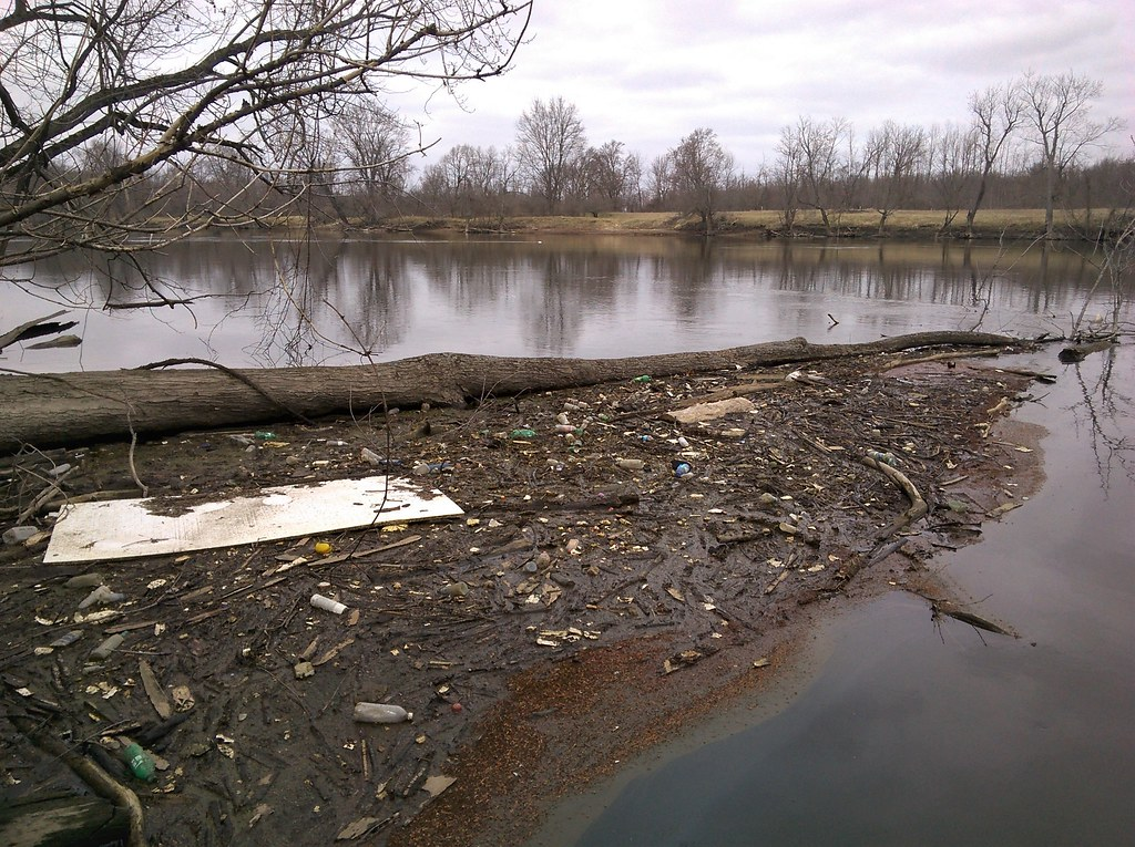 Strong winds blow plastic onto the Grand River