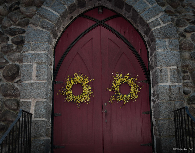 red double doors with wreaths