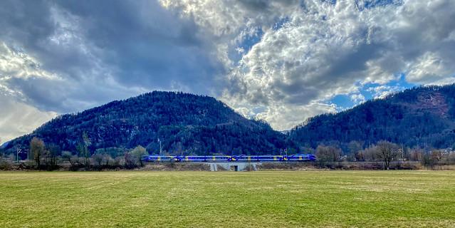 Meridian Regional Express train passing through the landscape near Oberaudorf in Bavaria, Germany