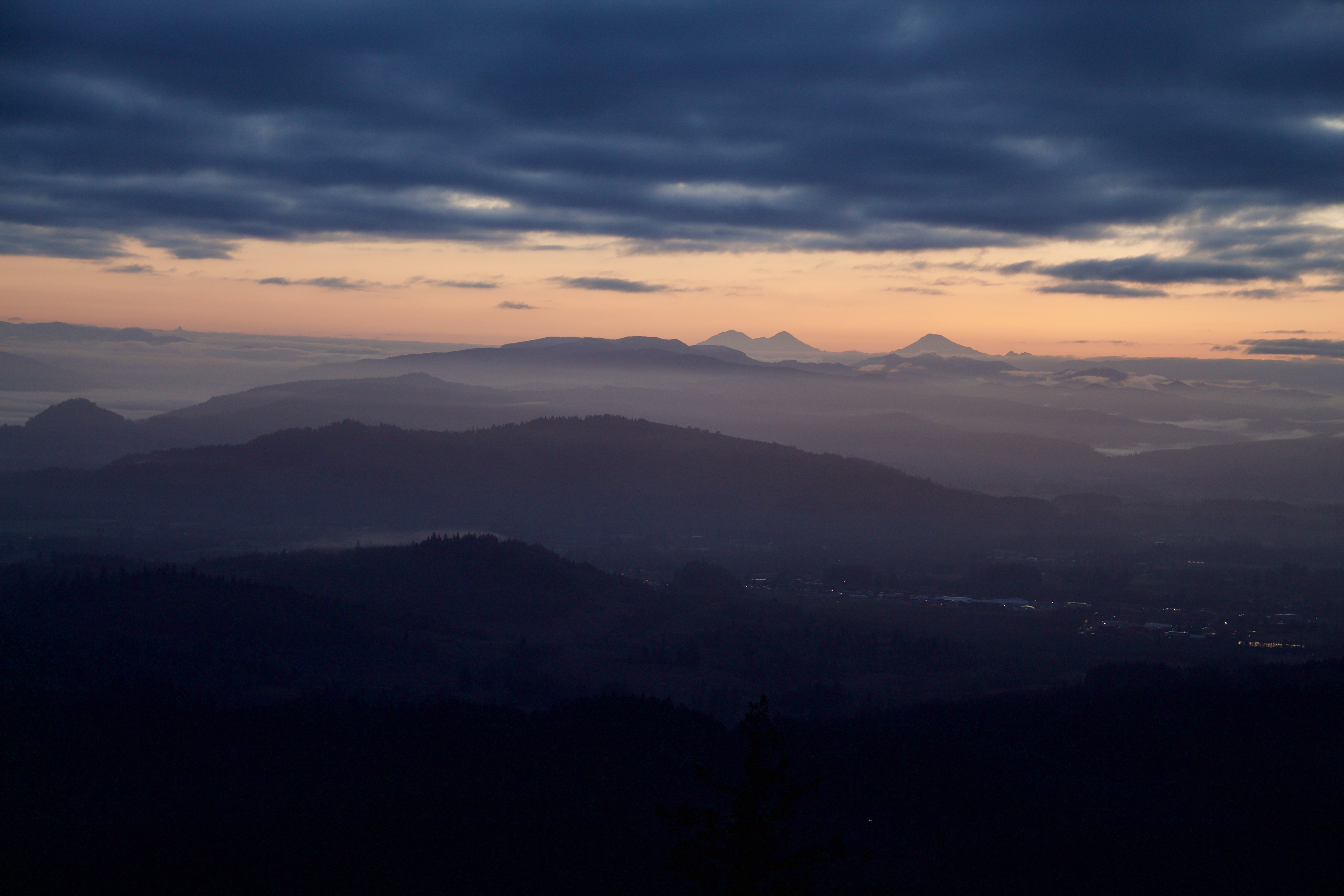 3 sisters right before dawn, with dark clouds above