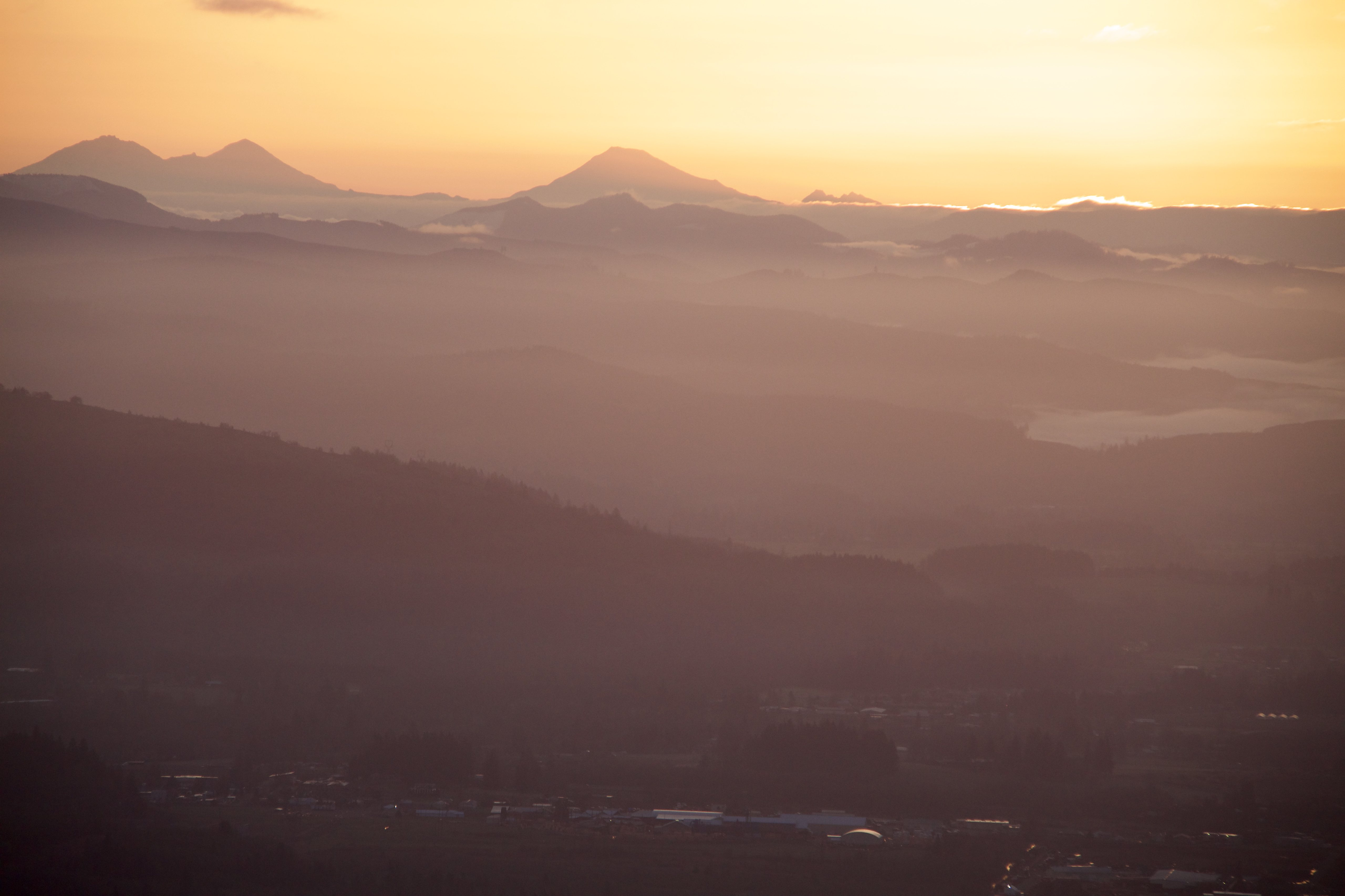 View of the 3 sisters from the west, but the sun cresting a bit over the horizon