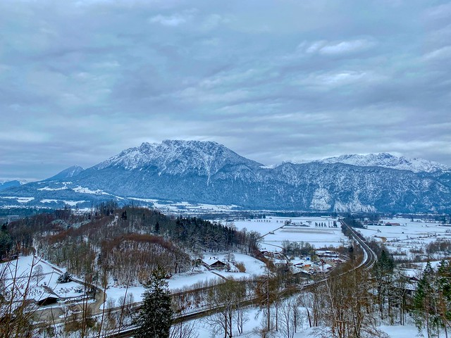 Winter view over the river Inn valley and Zahmer Kaiser mountain range from Auerberg mountain near Oberaudorf in Bavaria, Germany