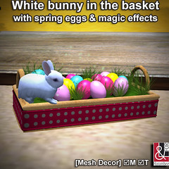 White bunny in the basket with eggs