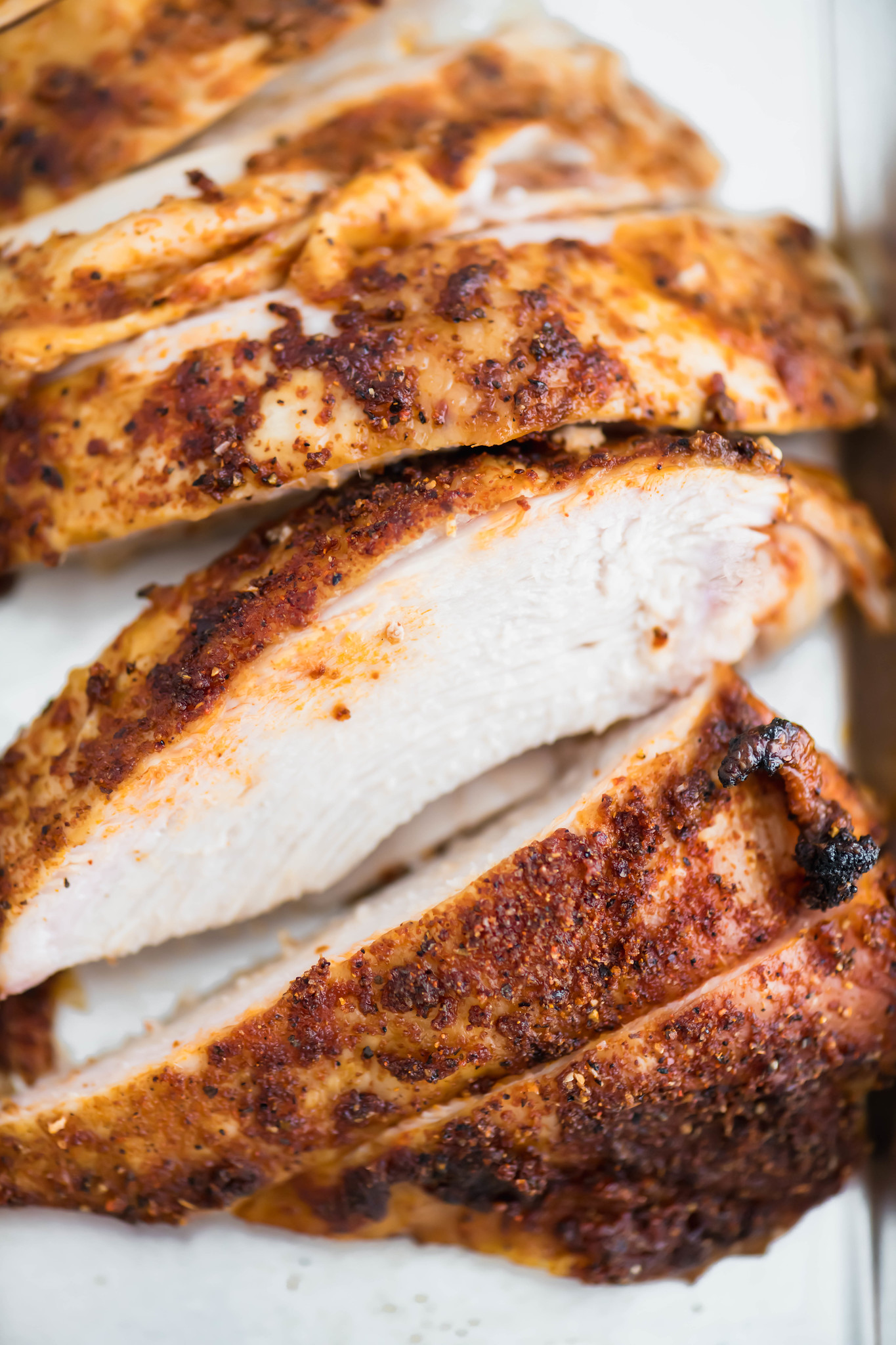 close up of slices of grilled beer can turkey