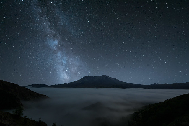 The Milky Way over Mount St. Helens and fog-covered valley, Washington State