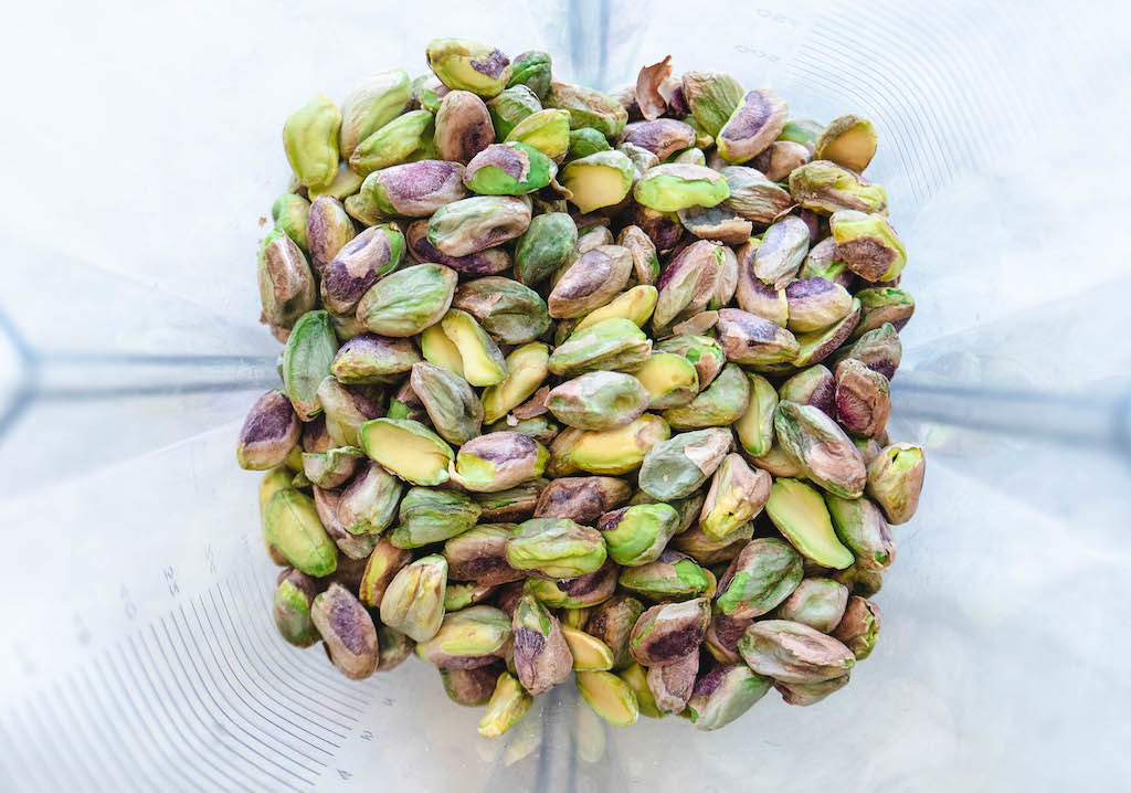 An overhead shot of the pistachios in a blender.