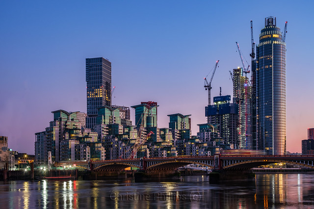 Glass and Stainless Steel - London's ultra modern skyline and the beautiful old Vauxhall Bridge. Christine Phillips