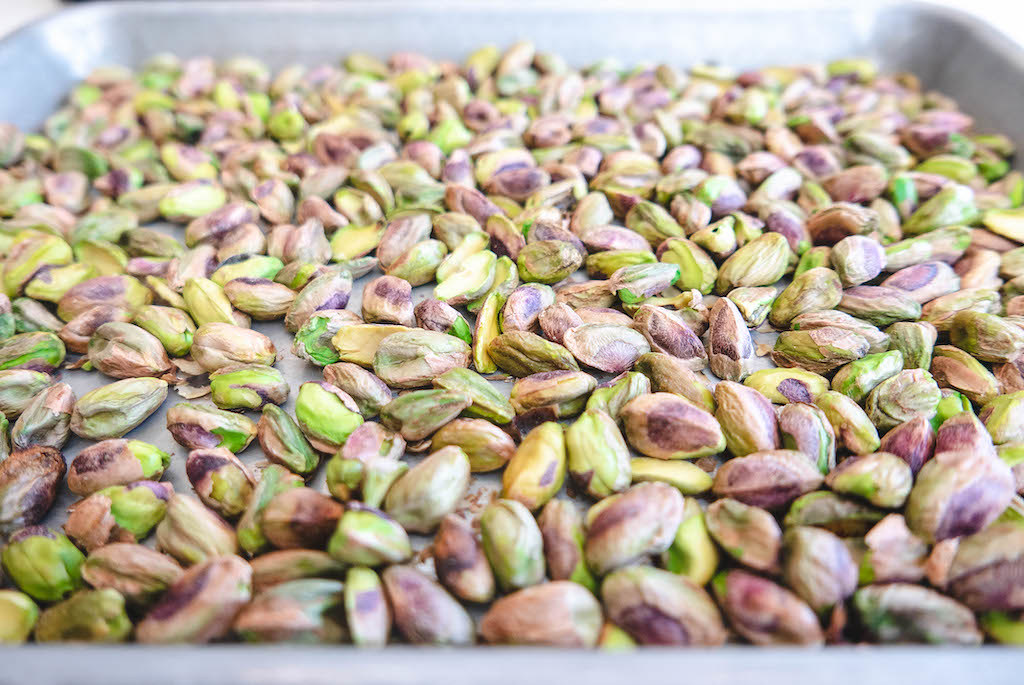 Pistachios sitting on top of a tray.
