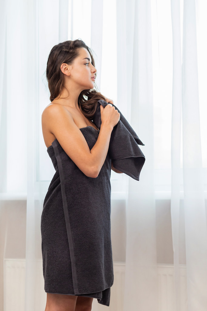 Woman wrapped in black Soji towel