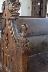 bench end: cowled figure with an open book (15th century)
