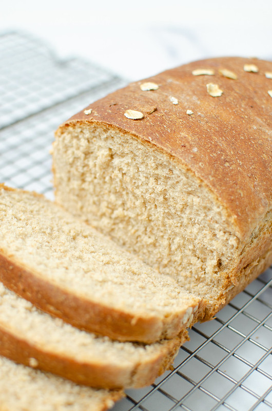 Wheat oat bread with several slices cut