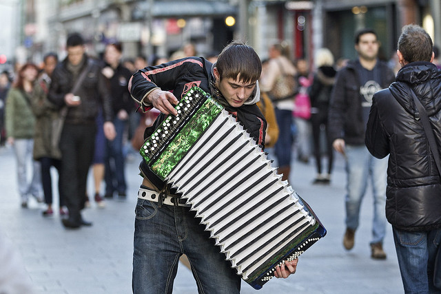 Busker giving it his all .....