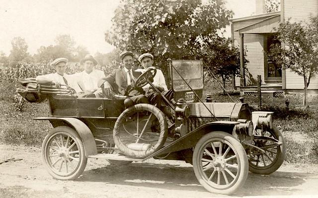 RPPC - Four Men in a Brass Era Auto