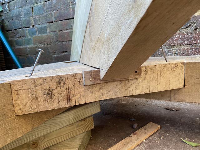 Opposing wedges - birdsmouth, left front green oak hip rafter