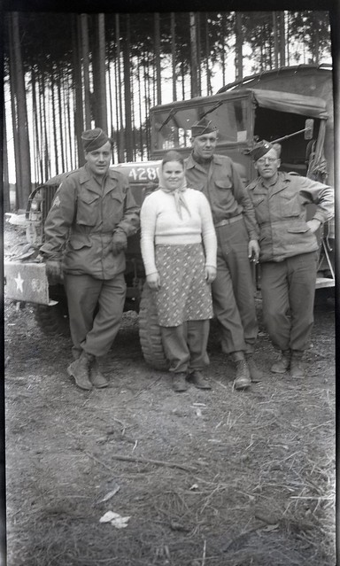 Personal Photo: Three American servicemen posing next to a truck with a woman.