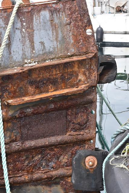 RUSTY TUG IN ALERT BAY,  BC.