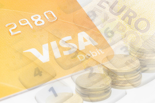 Visa credit card concept with Euro currency in the background