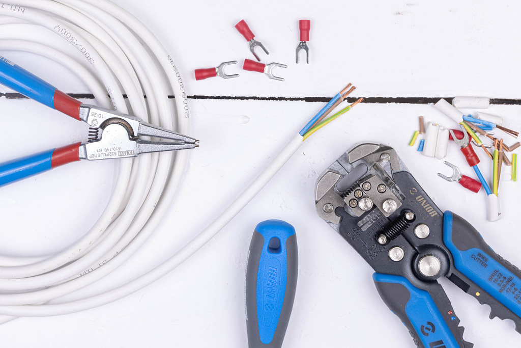 Top view of Crimp Grip Pliers above white background table
