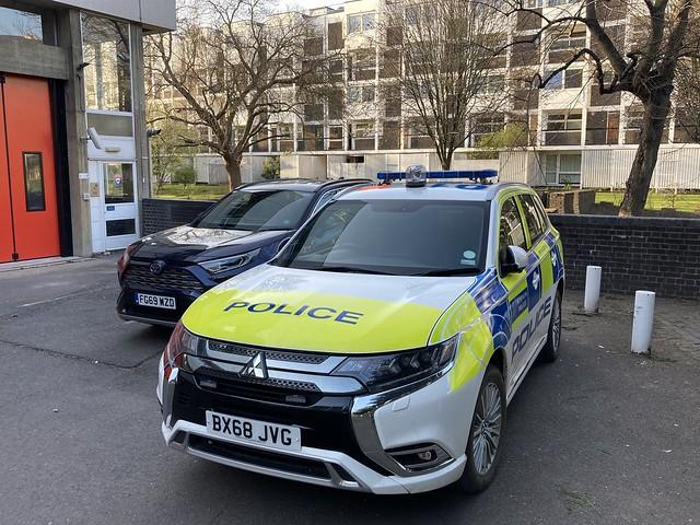 Metropolitan police Mitsubishi Outlander parked next to a fire officer car