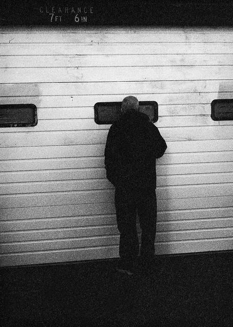 Man Peering into Police Station Window, Portland