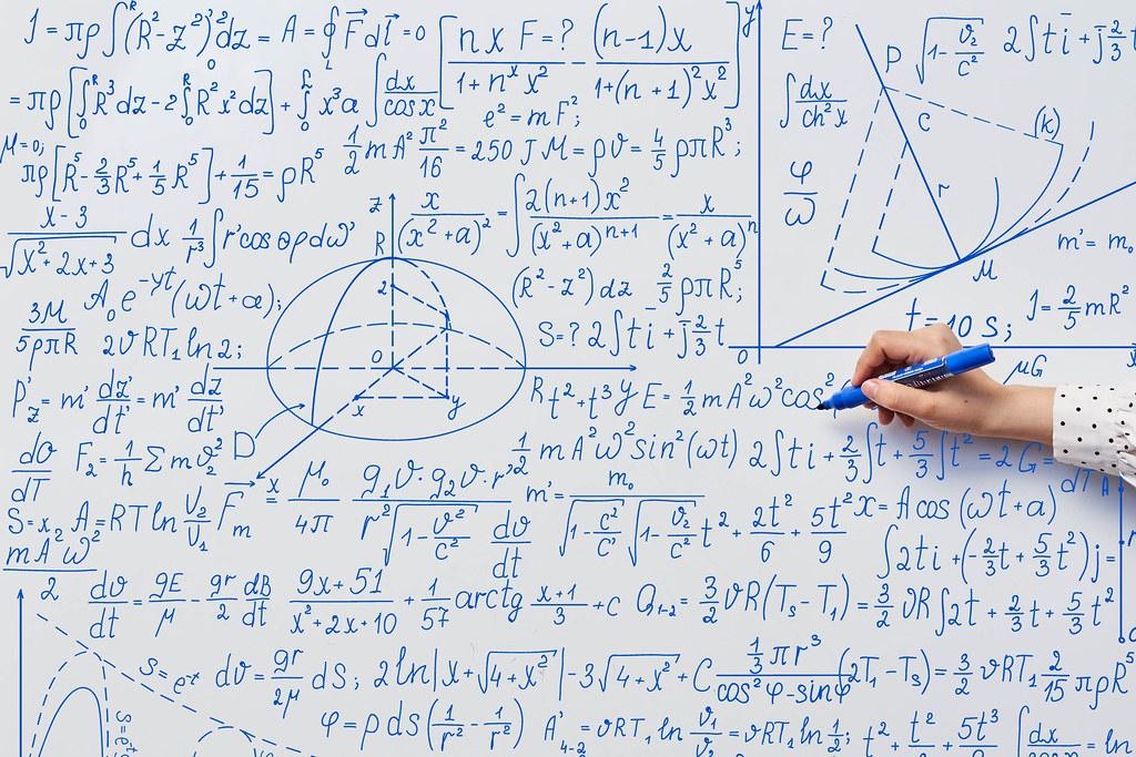 Teacher's hand writing complicated mathematical formulas o…   Flickr