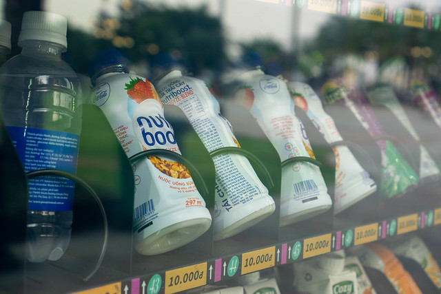 Close Up Photo of Different Cold Drinks in an Automatic Vending Machine with Price Tags and Numbers in a Public Park