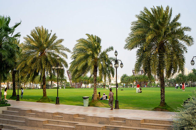 People walking, doing Sports and having Picnic at Vinhomes Central Park in Ho Chi Minh City, Vietnam