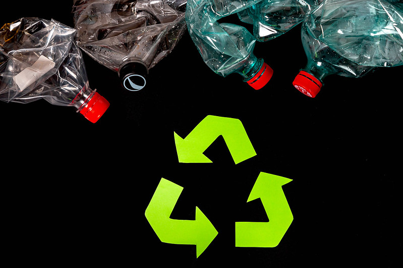 Eco concept with recycling symbol on dark background, top view
