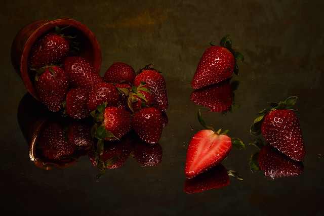 Overturned cup of strawberries
