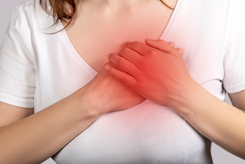 Heart attack concept, woman suffering from chest pain