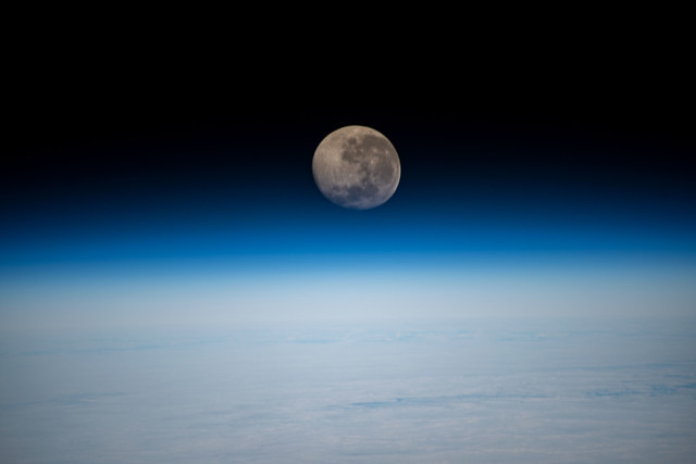 A waning gibbous Moon above the Earth's horizon