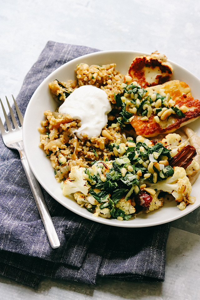 Roasted Cauliflower and Halloumi Bowls with Dates and Freekeh Pilaf
