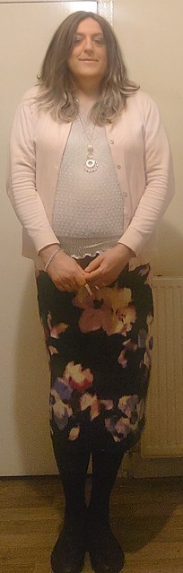 Floral print skirt and pink cardi