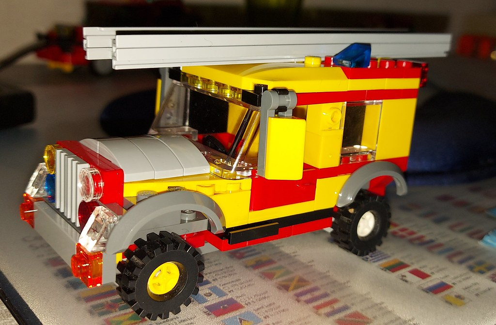 An old Land Rover Swedish yellow fire truck from the front.
