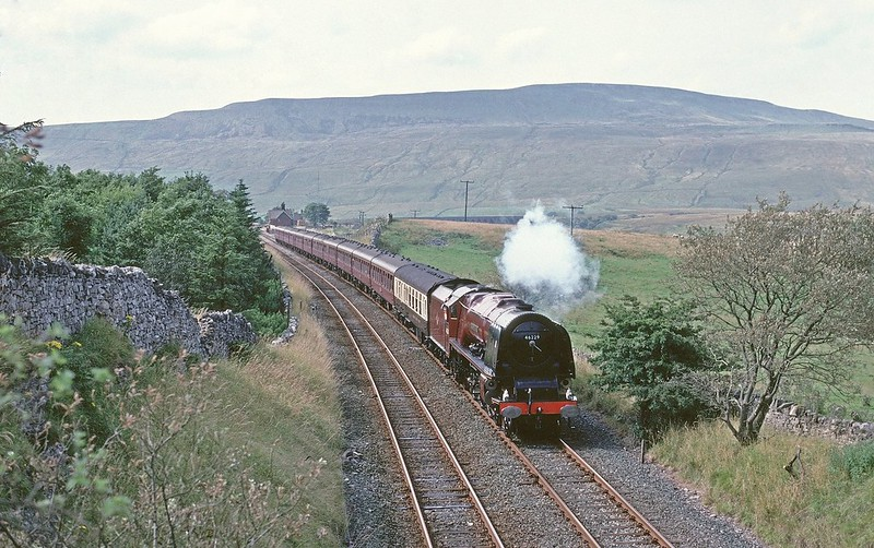 46229 Duchess of Hamilton keeps some steam on downgrade near Ribblehead on 14/8/1993.This was the day it gained the Blue Riband for the fastest recorded time from Appleby to Ais Gill Copyright David Price No unauthorised use