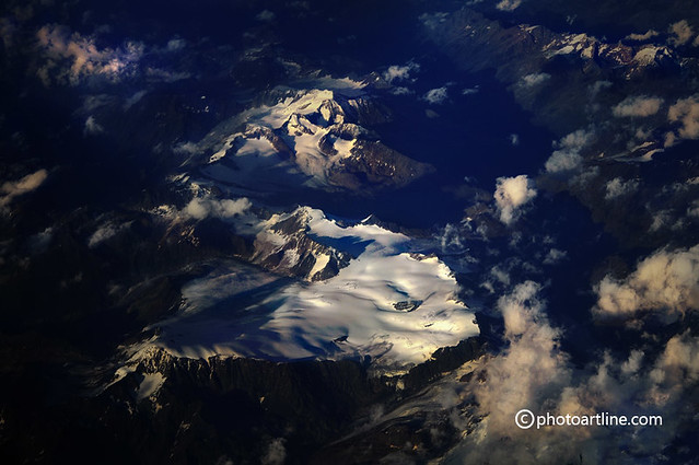 flying at sunset over a glacier in the italian alps